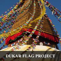 photo of famous Stupa in Bhoda Nath Nepal decorated with Drigung Kagyu prayer flags to promote loving kindness and the Dharma