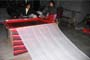 The vertical long flags (Tib. darchen) being manufactured in Sichuan by our Chinese contractors